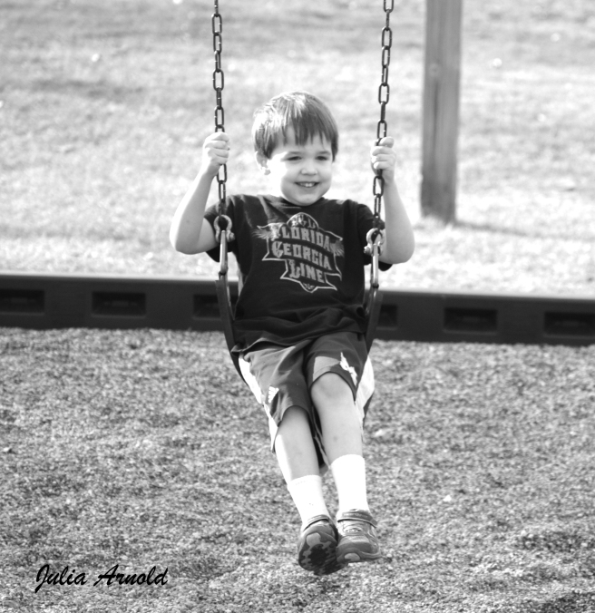 John on Swing in Black and White with Logo